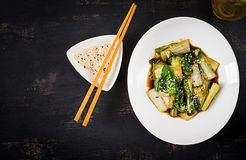 Bok choy vegetables stir fry with soy sauce and sesame seeds. Chinese cuisine. Top view royalty free stock photo
