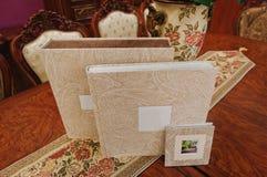 Bok för foto för textiltappningbröllop arkivbild