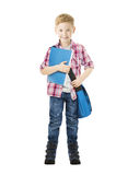 Bok för skolpojkebarninnehav Isolerad vit för studentskolapojke Royaltyfri Foto