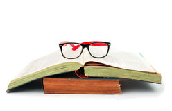 Bok med exponeringsglas arkivfoto