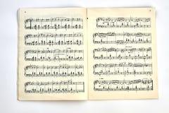 Bok med musikaliska anmärkningar Arkivfoto