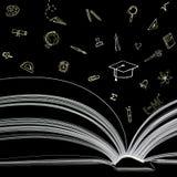 Bok med utbildningssymboler Arkivbild