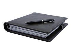 Bok och penna Royaltyfria Bilder