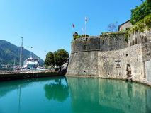 Boka Kotor. Harbour in Boka Kotor with cruise ship and fortification, Monte Negro Royalty Free Stock Image
