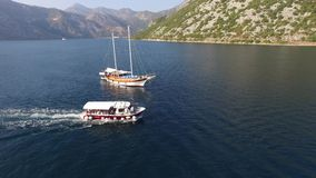 Boka Kotorska gulf of Kotor with two islands Gospa od Skrpjela Our Lady of the Rocks and Sveti Dordje. Strait of Kotor Bay in mountains. Adriatic sea stock video