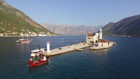 Boka Kotorska gulf of Kotor with two islands Gospa od Skrpjela Our Lady of the Rocks and Sveti Dordje stock footage