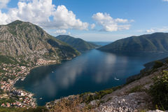Boka Kotorska, Kotor Bay, Montenegro. With blue sky and white clouds Royalty Free Stock Photography