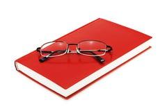 Boka med glasögon arkivbild