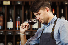 Bokal of red wine on background, male sommelier appreciating drink Royalty Free Stock Photo