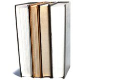 Bokbunt på en vit bakgrund Arkivfoto