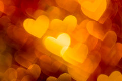 Фото красного и золотого boke сердец как предпосылка Стоковая Фотография