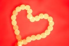 Boke dorato sotto forma di un cuore Fotografia Stock