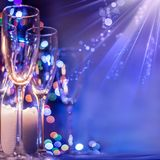 Boke glasses of champagne on the background of bright bokeh. Christmas royalty free stock image