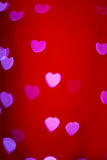 Boke Lovers of the heart. On a red background Stock Photo