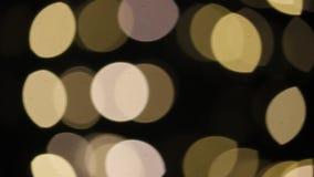 Bokeh背景金子金黄圣诞节欢乐闪闪发光闪光 股票视频