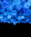 Bokeh蓝色点燃抽象背景 免版税库存图片