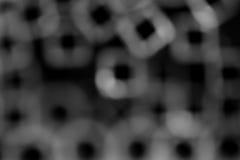 Bokeh à l'arrière-plan noir-gris de tons photographie stock