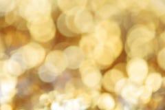 Bokeh στη χρυσή αφηρημένη θαμπάδα Στοκ Φωτογραφία