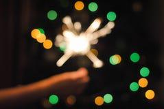 Bokeh της γιρλάντας και των sparklers Χριστουγέννων στοκ εικόνα