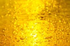 Bokeh желтого цвета и света золота стоковые изображения