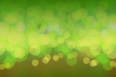 Bokeh зеленой природы сияющее запачкает предпосылку Стоковые Фото