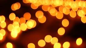 Bokeh или свеча нерезкости освещая абстрактную предпосылку сток-видео