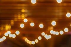 Bokeh на предпосылке, расплывчатые яркие света на темной предпосылке стоковые изображения