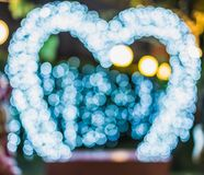 Bokeh освещает будочку фото рамки сердца Стоковые Изображения