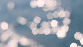 Bokeh освещает предпосылку волн моря абстрактную видеоматериал