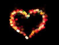 Bokeh освещает сердце влюбленности Стоковая Фотография