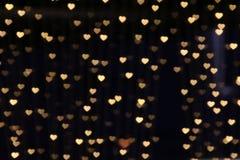 Bokeh предпосылки золота освещает нежность сердца, предпосылку сердца красочную Стоковое Изображение