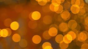 bokeh предпосылки золотистое много золотые расплывчатые света акции видеоматериалы
