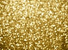 bokeh предпосылки золота абстрактное объезжает для предпосылки рождества Стоковое Изображение RF