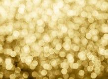 bokeh предпосылки золота абстрактное объезжает для предпосылки рождества Стоковые Изображения RF