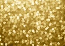 bokeh предпосылки золота абстрактное объезжает для предпосылки рождества Стоковая Фотография RF