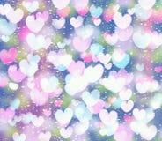 Bokeh сердца на голубой и розовой предпосылке Стоковые Фото