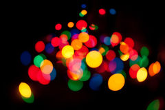 Bokeh. Color spots bokeh background on black Stock Image