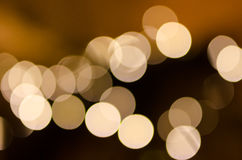 Defocused christmas lights background. Yellow abstract round bokeh balls Royalty Free Stock Images
