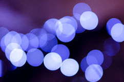 Defocused christmas lights background. Blue abstract round bokeh balls Stock Image