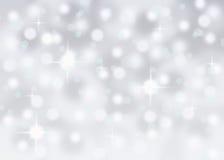 银色抽象bokeh雪落的冬天圣诞节假日背景 库存照片