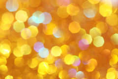 柔光桔子,金背景黄色,绿松石,桔子,红色抽象bokeh 免版税图库摄影