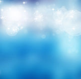 与bokeh光和星的抽象软的模糊的背景 库存图片