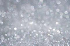 Серая предпосылка яркого блеска зарева Элегантная абстрактная предпосылка с bokeh Стоковое Фото
