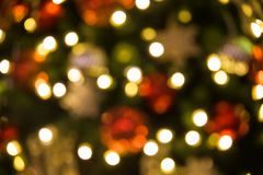 Bokeh abstract background of Christmas tree. Blurred bokeh abstract background of Christmas or xmas tree with light bulbs and snow flake Stock Images