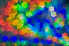 Bokeh, abstract colorful background of defocused hexagon stars. Festive lights and flicker royalty free stock photos