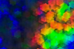 Bokeh, abstract colorful background of defocused hexagon stars. Festive lights and flicker stock photography