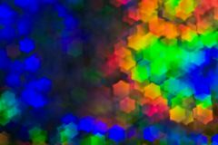 Bokeh, abstract colorful background of defocused hexagon stars. Festive lights and flicker stock photo
