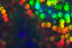 Bokeh, abstract colorful background of defocused hexagon stars. Festive lights and flicker royalty free stock photo