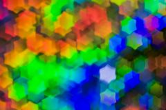 Bokeh, abstract colorful background of defocused hexagon stars. Festive lights and flicker royalty free stock image