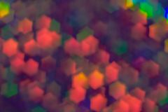 Bokeh, abstract colorful background of defocused hexagon stars. Festive pale pink decoration stock photos